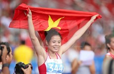 Vietnam dominates international athletics tournament in HCM City
