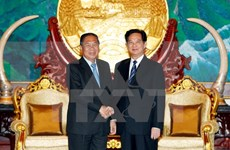 Vietnam, Laos vow to treasure bilateral ties
