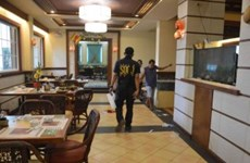 Suspects in diplomat killing flown to China for trial