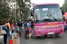 20,000 poor workers offered free home-coming buses in Tet