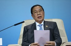 Laos issues new Constitution