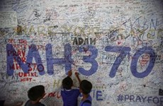 No answers in interim report on missing MH370