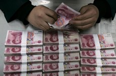 Seven Chinese jailed for illegal cash transfers