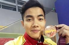 Hung wins parallel bars bronze at Doha Gymnastics World Cup