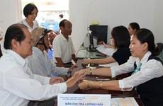 HCM City: More districts launch pension payment service via post