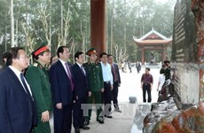 President Tran Dai Quang visits K9-Da Chong historic site