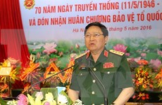Defence minister pays official visit to Laos, attends ADMM-10