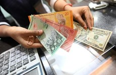 Malaysia to apply new exchange rate