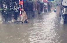 Hanoi's streets turned into rivers after heavy rain