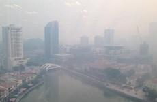 Singapore closes schools as haze conditions worsen