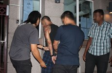 Malaysian police arrest three terrorist suspects