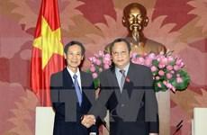National Assembly Vice Chairman greets Lao legislator