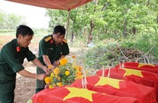 Quang Binh reburies Vietnamese martyrs' remains found in Laos