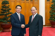 PM receives Lao minister, Chinese group chairman
