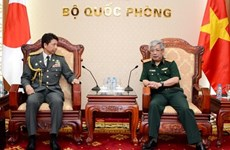 Defence officer receives Japanese military attachés