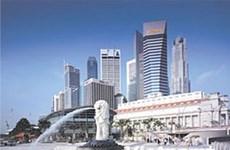 Singapore lowers 2015 GDP growth forecast