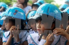 Safe helmet use spotlighted in Hanoi