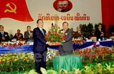 Party chief congratulates his new Lao counterpart