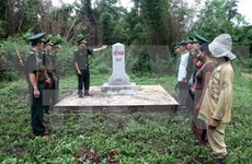 Vietnam, Laos review border cooperation