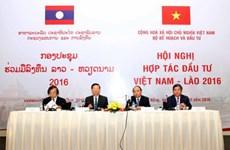 Vietnam, Laos step up investment ties