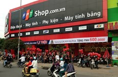 FPT to sell retail, trading units