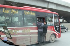 Hanoi cracks down on overcrowding in coaches