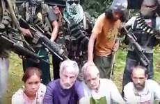 Philippine rebels threaten to murder hostages