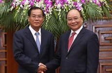 PM urges ministries of Vietnam, Laos to foster economic links