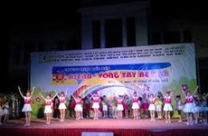 Int'l event gathers Vietnamese, Lao, Cambodian children