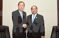 PM meets Australia counterpart, UN leader in Vientiane