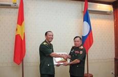 Young Vietnamese, Lao officers join exchange activities