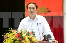President meets HCM City's voters