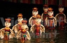 Artisan dedicates to water puppet making