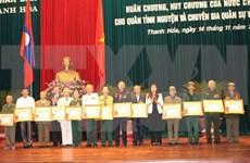 Laos honours Vietnamese voluntary soldiers, experts