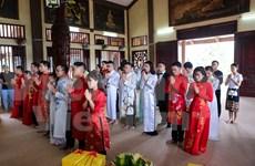 Buddhist wedding ceremony organised for 14 couples in Hanoi