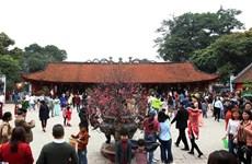 Visitors flock to Van Mieu - Quoc Tu Giam on Tet holiday