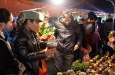 Visitors buy luck at Vieng Market in Nam Dinh province