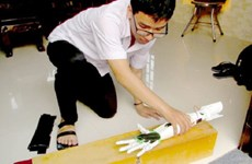 Student invents robotic arm for the disabled