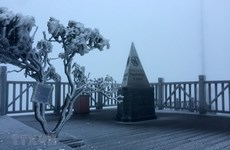 Mount Fansifan covered with ice as cold spell strikes the north