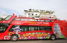 Hanoi's double-storey bus service thrills tourists