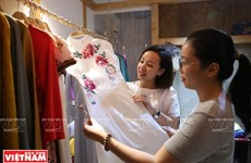 Brilliance of hand-embroided Ao Dai
