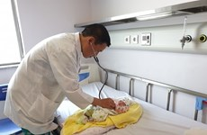 Lao newborn given complicated cardiac surgery by Vietnamese doctors