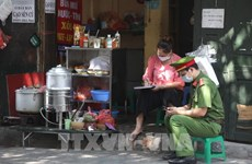 Hanoi raises COVID-19 alert following new infections