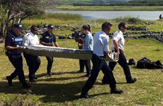Malaysian investigators probe plane debris for MH370 link