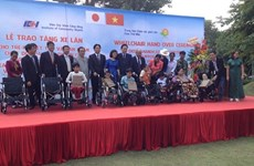 Former Japanese PM presents wheelchairs to AO victims