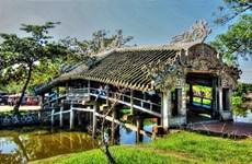 Hue's tile-roofed bridge a big tourist draw