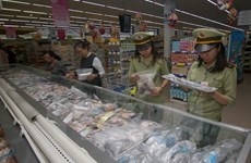 Officials urge tighter food safety control