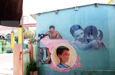 Mural brightens up Tam Thanh fishing village
