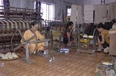 Woman weaves silk from lotus