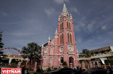 Touring the pinky church in downtown Ho Chi Minh City
